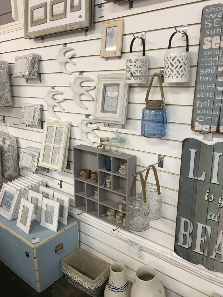 Pretty Slatwall Display - White Slatwall panels with Slatwall accessories - #slatwallpanels #slatwallhooks - Slatwall gondola units available to match the panels. Wide range of colours and wood finishes.