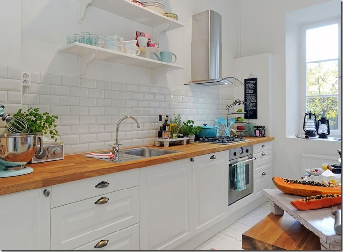 subway tiles, white cabinets, windows