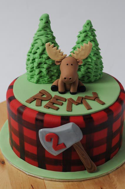 Woodsy Canadiana Moose Cake. Red plaid, axe, pine trees and moose.  Cakes by Caralin. www.cakesbycaralin.com
