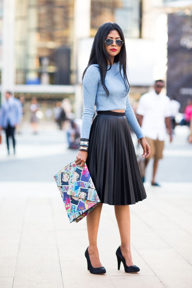 A black pleated midi skirt can be a great way to get a sexier, edgier style. Sheryl Luke wears this number with a cute cropped sky blue sweater and matching black heels. Top/Skirt: Topshop, Shoes: Coye Nokes, Clutch: Elisabeth Weinstock, Cuff: Sibilia.