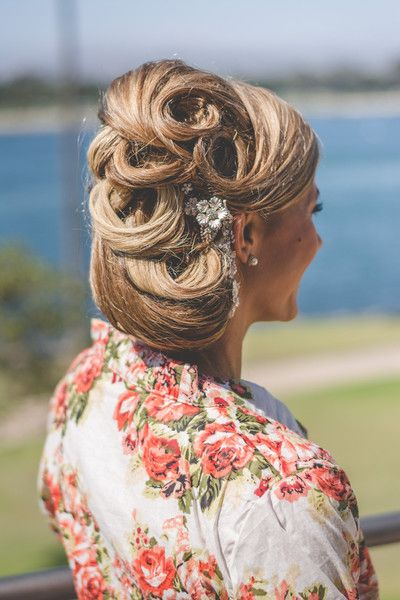 Unique, elegant wedding day updo with curls + crystal hair piece {Brit Jaye Photography}