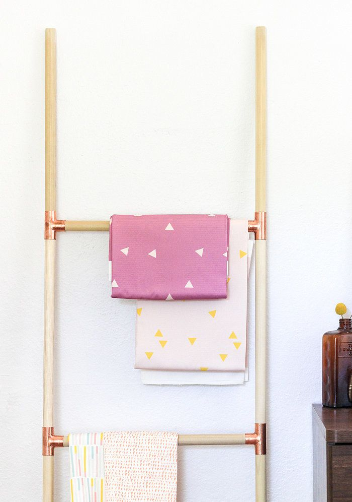 Make your own luxe ladder to hang your belongings.