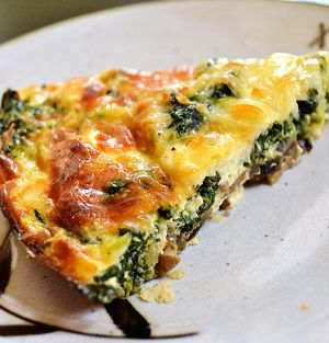 Oven baked spinach and mushroom tart.This is one of my favorite tarts.The rich combination of flavors in this spinach and mushroom tart is delicious with crispy pastry.