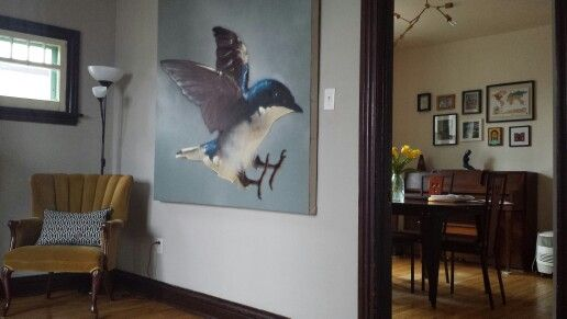 Our present apartment. We love our blue bird by Montreal graffiti artist Arpi. We love our chandelier. We love our display wall with pictures and mementos from our travels. Elaine often admires the statue, a family heirloom.