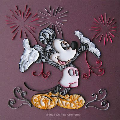 Quilled Mickey Mouse.  I haven't quilled in ages, but this doesn't look too complicated (with a Mickey template).  Would make a great cover for an autograph book or trip album.