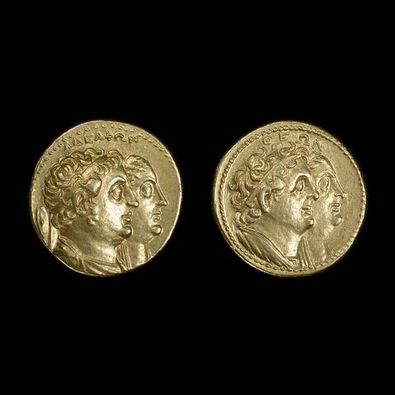 """One of the finest gold issues of the Ptolemaic Dynasty, c. 285-246 BCE. The Greek inscription says """"Divine(Theon) Brothers(Adelphon)"""" or """"of divine siblings"""". This issue was produced by the second Ptolemaic ruler, Ptolemy II Philadelphus (284-246 BCE). He was given the epithet Philadelphus, which means 'sister (or brother)-loving' in Greek, due to his marriage, in Egyptian style, to his sister Arsinoe II."""