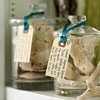 Memory Jars  For a quick gift for fellow travelers, fill a glass jar with beach items. Tie a tag around the lid with a date and description of the trip to help friends remember the great time you had together.
