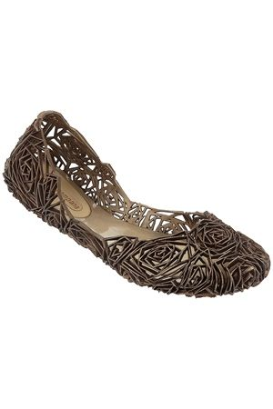 Melissa Shoes Campana Fitas - Brown Delicate floral cutout design romances any outfit. Designed by the Campana brothers, as a Melissa collaboration. Chic style doesn't get any more comfortable than the Campana Fitas. The bold brown is a versatile compliment to comfy shorts and a tee, or your favorite summer dress.