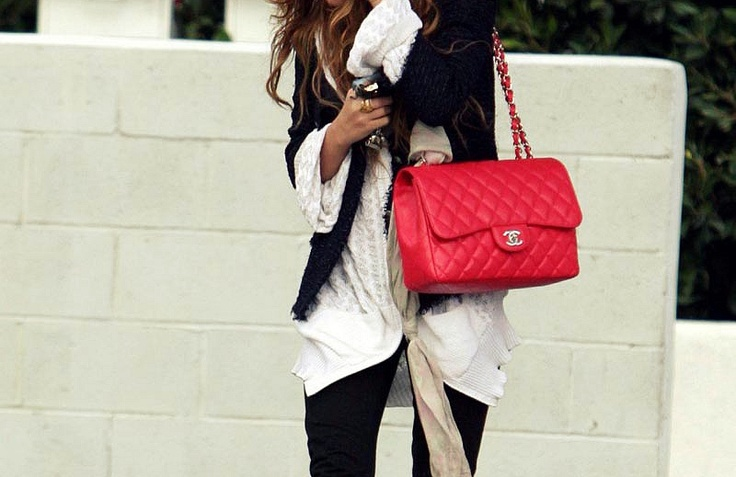 Super cute red Spring/Summer Chanel bag. Need a little color in my life :-)