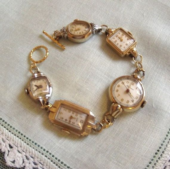 artisan made bracelet / upcycled  antique watch faces / dials.  love the vintage jewelry style