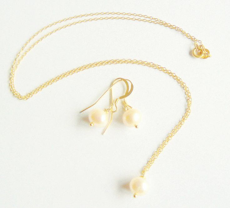 gold vermeil and freshwater pearl set by clutch and clasp | notonthehighstreet.com £39.95