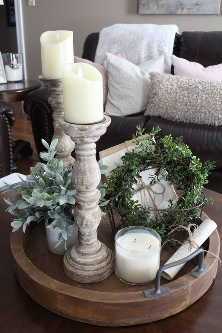 Beautiful Circle Tray With Candles Boxwood Wreath And More Make Interesting Living Room Table Decor