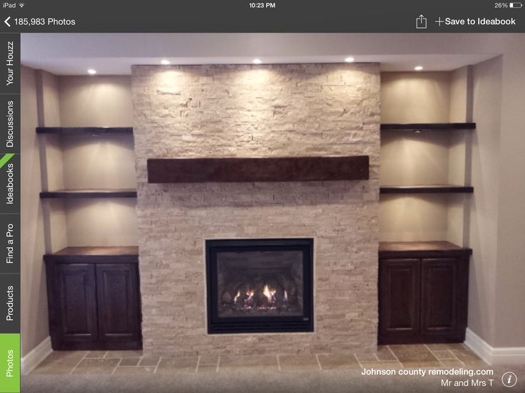 Ok, this is actually almost exactly what we'd have to do in our living room. The fireplace would need to jut out, which would leave sunken walls on either side, which is where we'd put floating shelves.  We would use wood panels instead of stone, a larger, chunkier mantel and no cupboards.