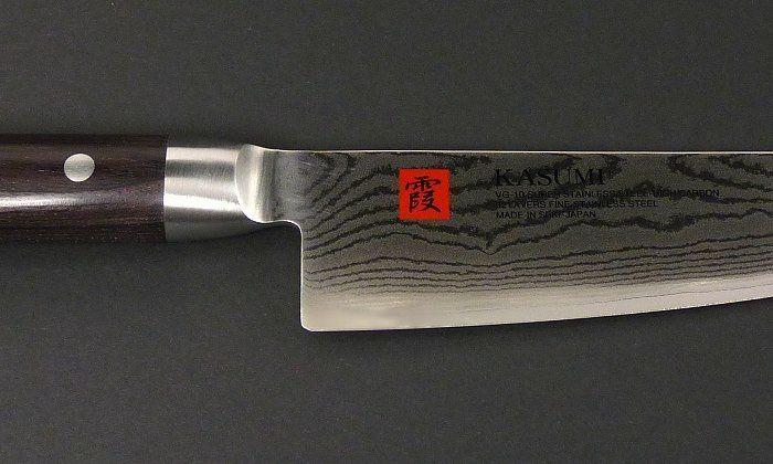 Kochmesser32 Lagen Damaststahl Klingenlänge: 20 cmGesamtlänge: 32,5 cmKlingenhöhe: 4,0 cmGewicht: 200 Gramm