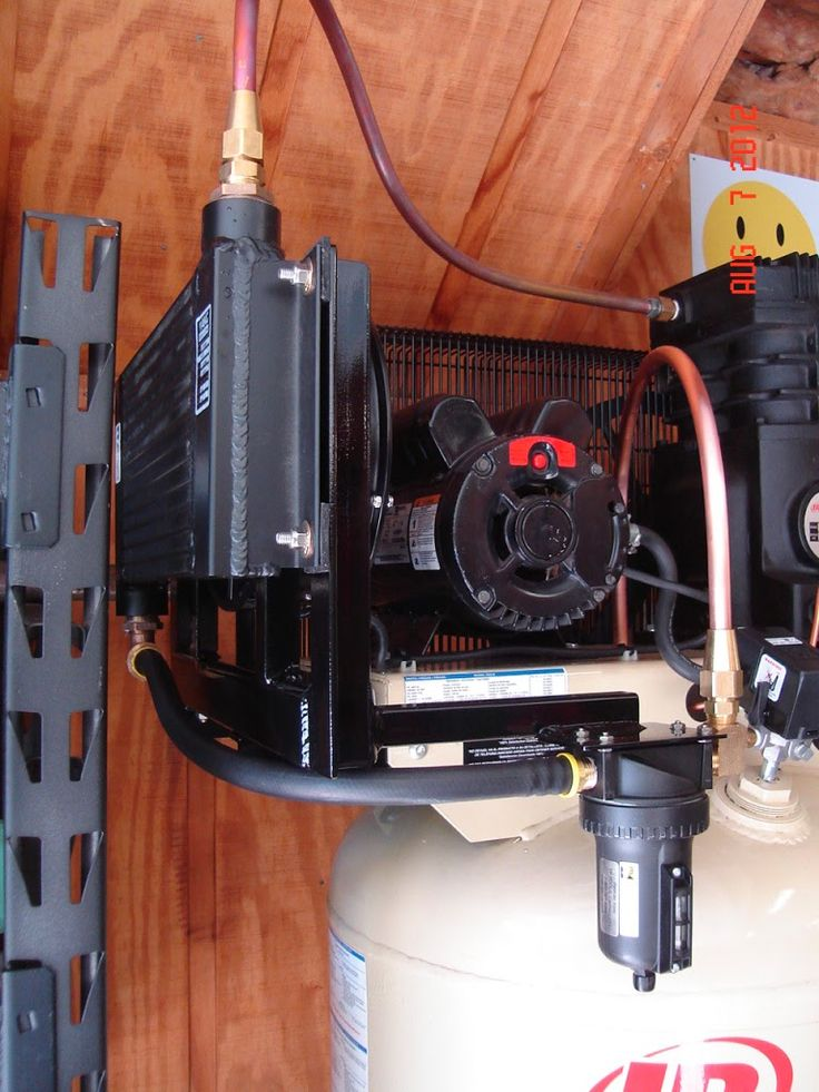 Air Compressor aftercooler.  Cool and drain water before it even reaches your tank.