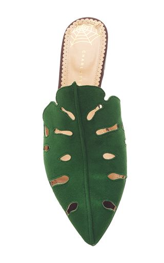 This **Charlotte Olympia** slipper is rendered in suede and features Monstera leaf cutwork and a wooden heel.