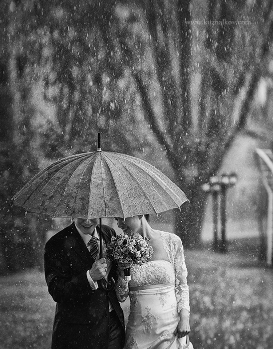 What a romantic photograph! Umbrellas are timeless in photographs and wonderful for rain or shine!