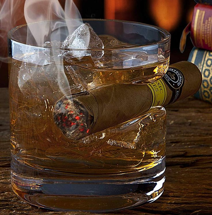 Old fashioned whiskey glass with indented cigar rest old