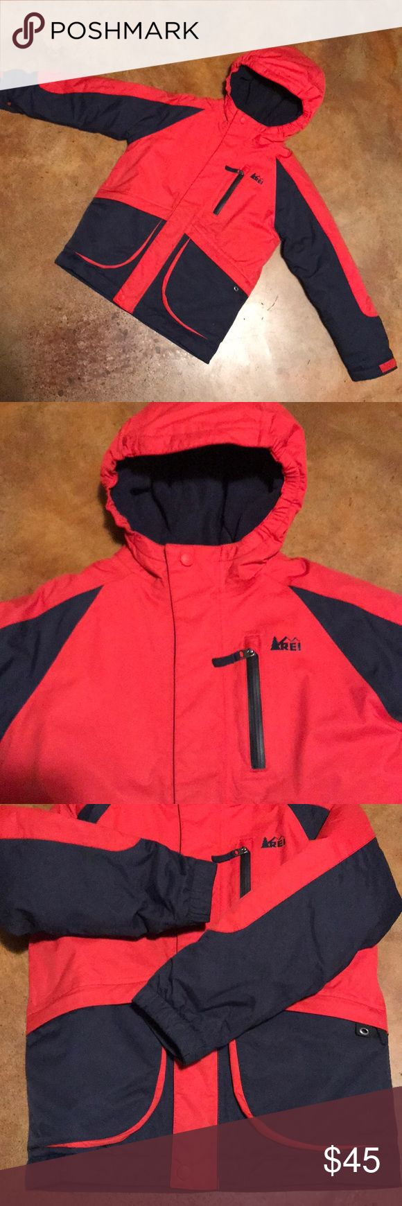 REI Ski Jacket Red with navy blue hooded, fleece lined winter waterproof jacket. Excellent condition. Size 6/7  ❄️Built for winter fun, the boys' REI Timber Mountain Jacket covers kids with full-blown windproof, waterproof, breathable protection. Size 6/7 REI Jackets & Coats