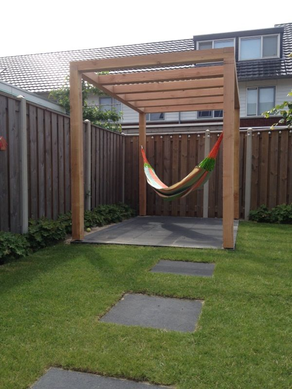 Selfmade design pergola with hammock maybe interweave fabric to create a fauxe ceiling for shade?
