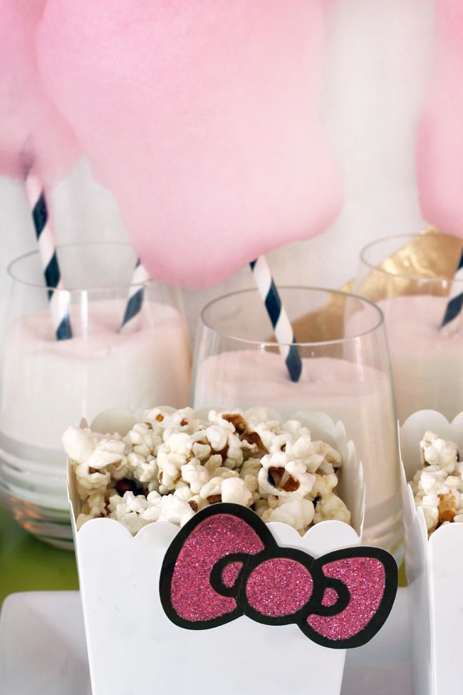 Simple popcorn boxes get a Hello Kitty makeover by adding glitter bows (cut out of store bought invitations)