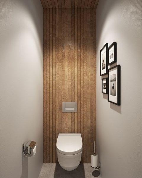 Super tof idee voor in het toilet! Trek de muurafwerking achter het toilet helemaal door tot en met het plafond! [via @decoist] #interieurinspiratie #interiordesign #toilet #interieur #interior #badkamerinspiratie
