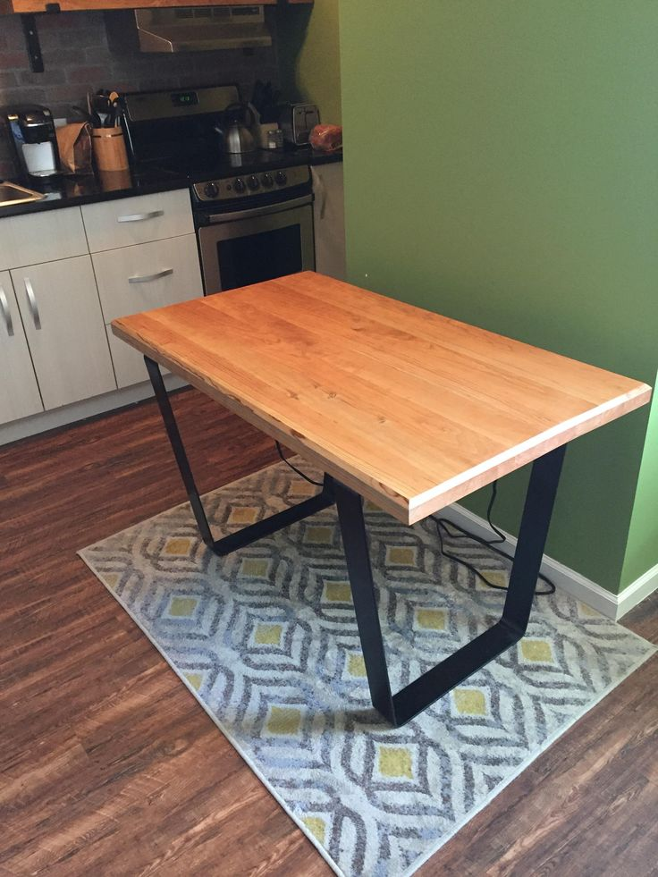 """Desk I just finished. Top made out of 8/4 cherry with a shellac finish and the legs are 3"""" flat steel. (Warning: Very heavy) http://ift.tt/2pJIpk4"""