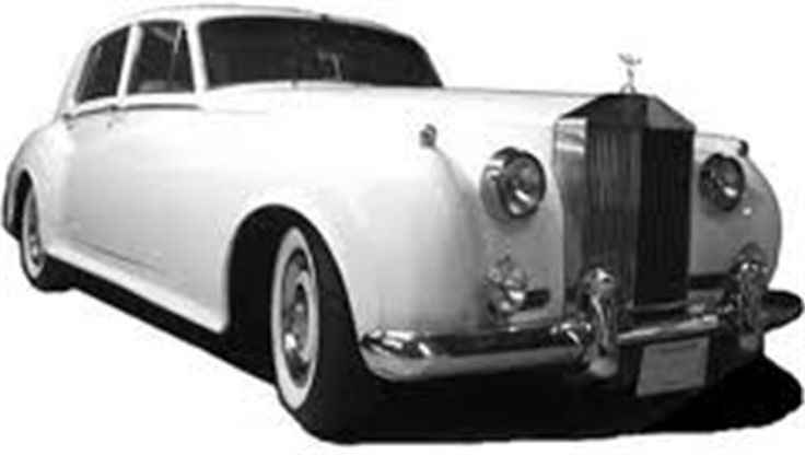 Old Rolls Royce with a pearl white paint job!