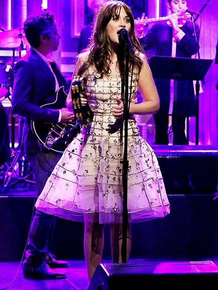 Zooey Deschanel breaks out her sparkly dress and tambourine to perform with her band, She & Him, on Wednesday on The Tonight Show with Jimmy Fallon in N.Y.C.