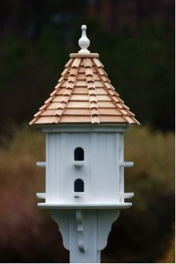 Dovecote birdhouse is constructed of cellular expanded PVC with durable cypress roof. Made in the USA, components are manufactured on a CNC router to ensure absolute precision and quality. Vinyl will