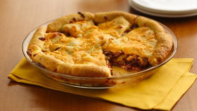 """Cheeseburger Crescent Bake: mix 1 lb cooked ground beef, .5 c ketchup, .25 c relish, 1 c shredded American cheese in skillet; spoon into 9"""" glass pie plate. Separate 1 can crescent rolls, place on top of meat mix with points towards center, cover with .5 c cheese. Bake @ 375 for 15-20 min."""