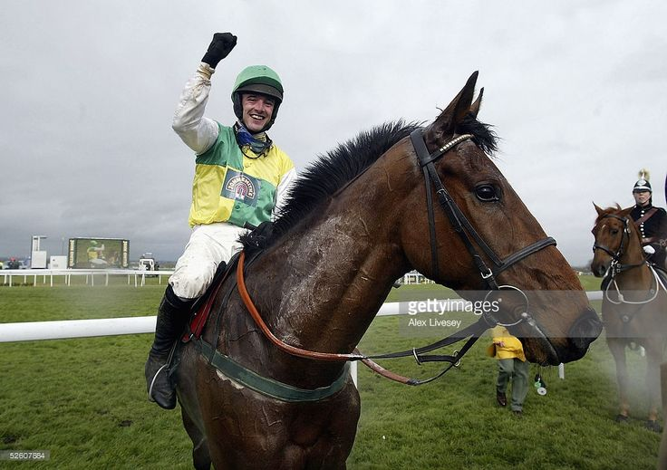 Ruby Walsh celebrates winning the John Smith's Grand National Steeple Chase race on Hedgehunter at Aintree Racecourse on April 9, 2005 in Aintree, England.