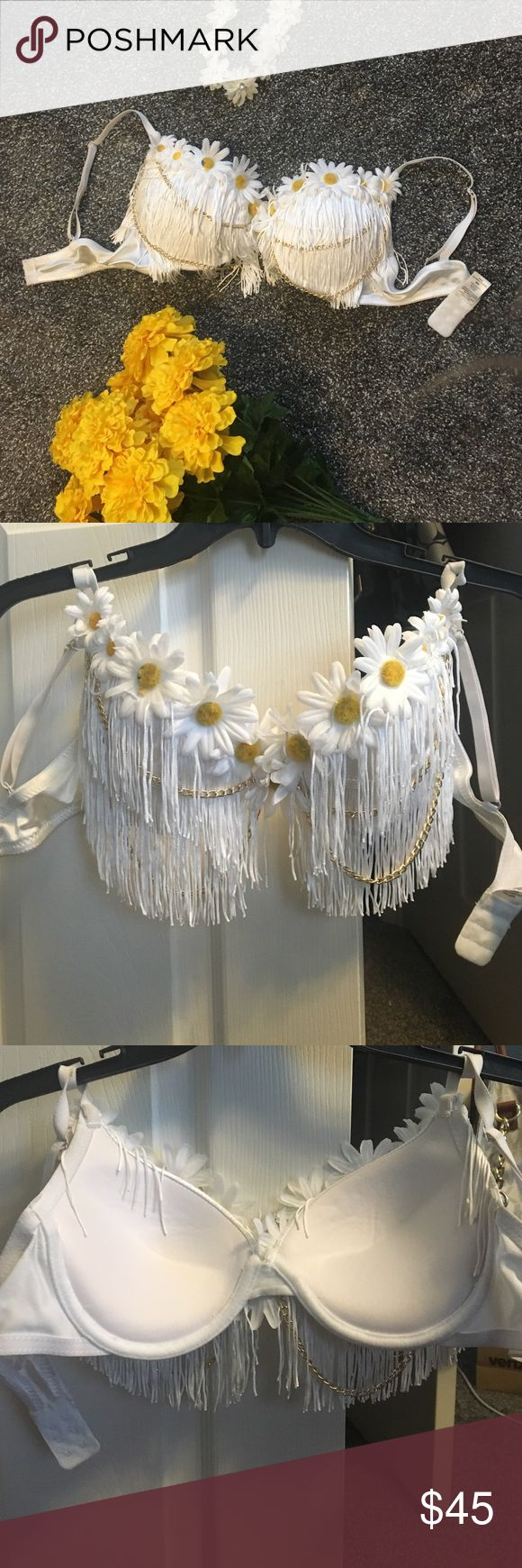 Festival bra top Used once, ready to attend another festival! Very comfy, has push up padding, only flaw is one flower is losing some yellow on the inside but thats all, white fringe with gold chain detailing and daisys, open to reasonable offers, no trades Other