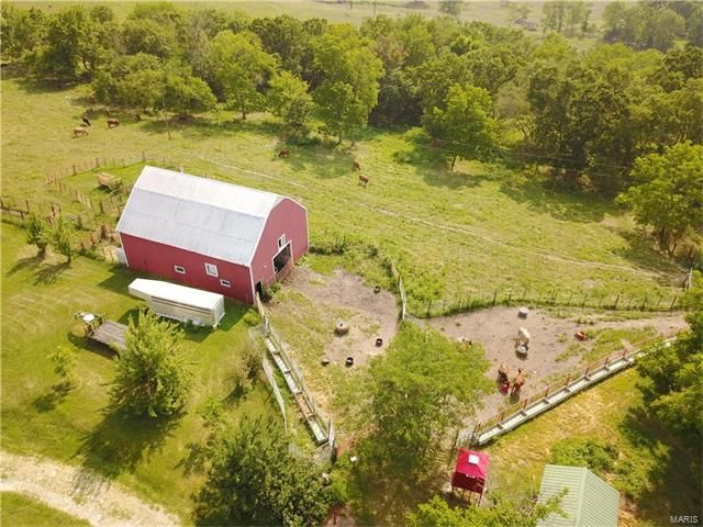 Motivated Seller.......Bring the livestock, 145.5 acres m/l fenced to do rotational grazing. Major updated farmhouse, features 4 BR 1 1/2 BA, Large country kitchen, pantry, breakfast nook, formal dining, office, large mudroom/laundry on main floor, bay window in living room, covered front porch, deck , large tornado room on 18'' concrete, jetted tub, 7x10 walk-in closet, five ponds, some spring fed, springs. Hwy frontage as well as gravel road frontage, 98% open, pasture in Houston MO