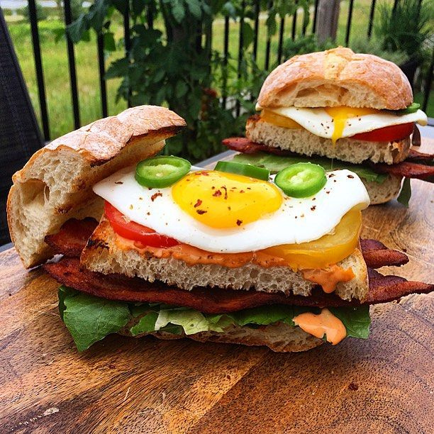Sunday morning sandwiches. Pugliese loaf cut into 3 layers and toasted on the grill, topped with sriracha mayo, thick cut bacon, eggs, lettuce, tomatoes, jalapeños and a sprinkle of ghost chillies. Enjoy your day! ☀️@zimmysnook