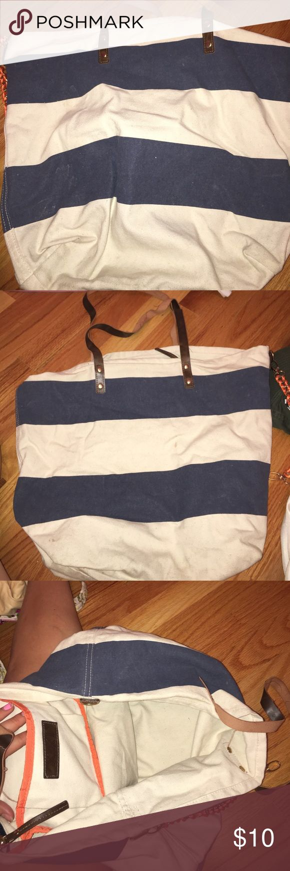 Striped tote bag Striped blue and white tote bag - blue and white. HAS A FEW STAINS (as shown in picture) Bags Totes