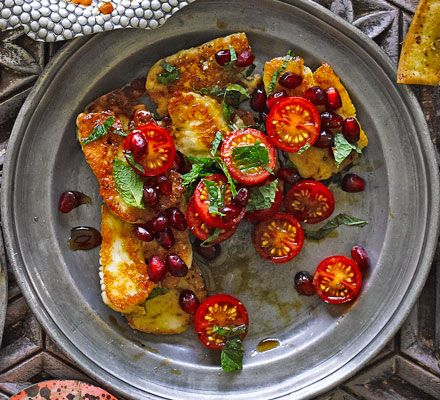Halloumi with tomatoes & pomegranate molasses: Salty halloumi cheese, sweet pomegranate molasses and fresh mint make a delicious combination in this quick Lebanese meze dish