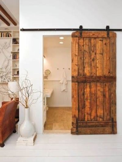 Hang two matching original doors from the house in a barn door style for the entryway to the attic storage area