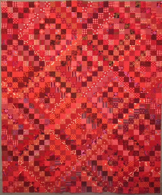 nifty quilts made this red scrappy trip around the world with Bonnie's tutorial