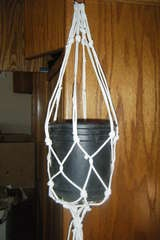 How to make your own hanging plant holder.  I'll have to try this out :P