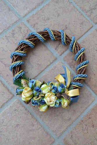 MEDIUM SIZED WREATH – Avion Blue - PatriziaB.com  Bring good tidings of joy with this handcrafted wreath. Woven from wicker, it is embellished with silk cordon spirals and decorations
