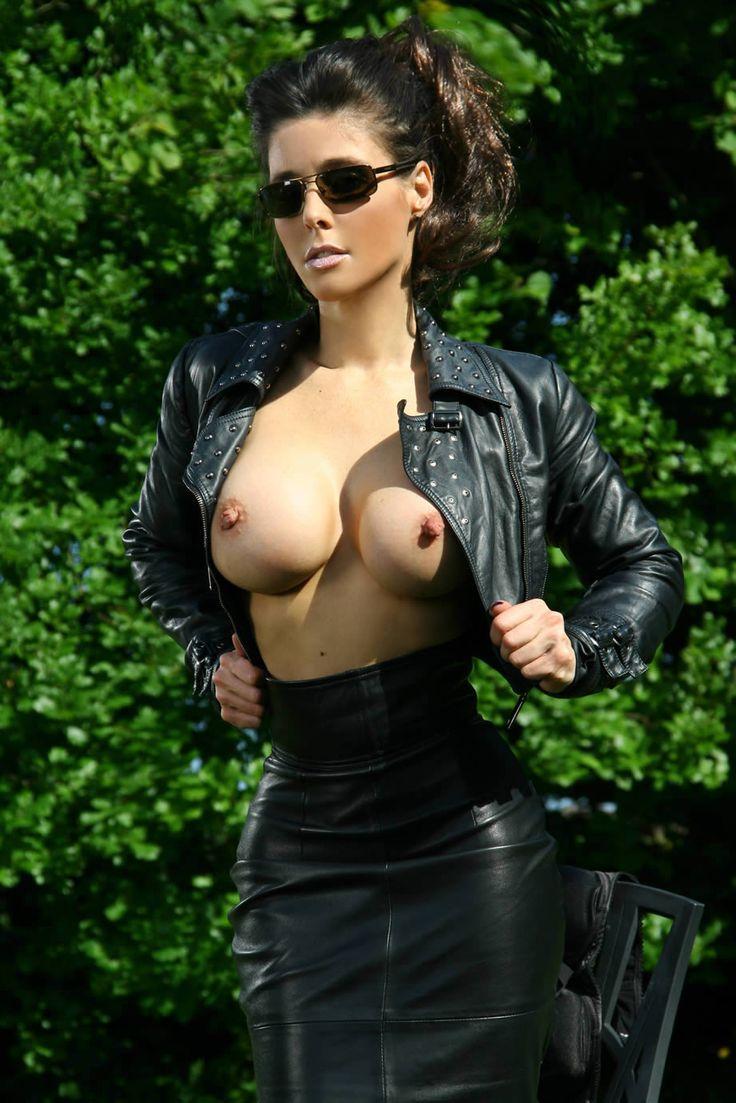 image Dark latex fetish suit on brunette rubber babe elisa in black plastic stock