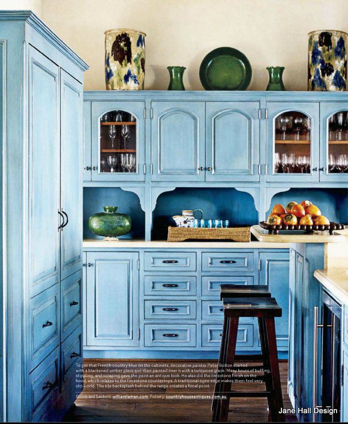 Great combination of blue painted and distressed cabinets