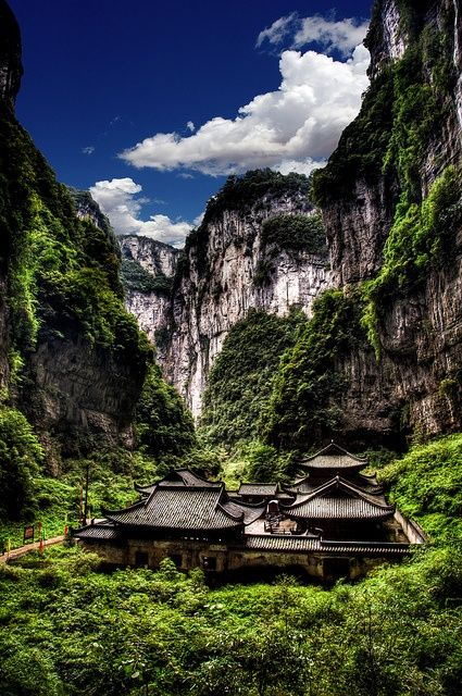 #CHINA - The Wulong Karst karst landscape located within the borders of Wulong County, Chongqing Municipality, People's Republic of China. It is divided into three areas containing the Three Natural Bridges, the Qingkou Tiankeng and Furong Cave respectively. It is a part of the Wulong Karst National Geology Park as well as part of the South China Karst, a UNESCO World Heritage Site. #Cina