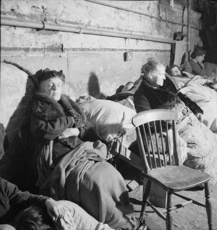 Christ Church, Spitalfields: Close up of Londoners asleep on makeshift beds and chairs.War time London by Bill Brandt, November, 1940. S)