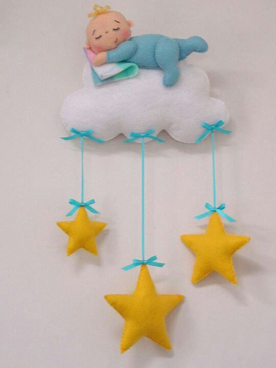 Baby riding a cloud with stars felt wall hanging