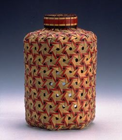 This is a hexagonal weave basket. The hexagonal weave is inspired by an ancient Japanese technique, and in this picture the base was made, then different colors were interlaced into it to give it the sharp distinction between the two colors.