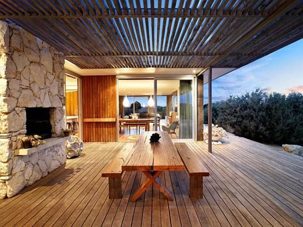 Contemporary House on Australia's Ocean Coast want an outdoor fireplace overlooking the north - plus openable glass wind breaks