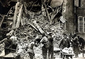 May 1940, Soldiers and rescue workers search in the ruins of a block of flats after a German aerial bombardment in Nancy, northern France, Germany's victory in France in 1940 followed the 'Phoney War, (September 1939-April 1940) and the German breakthrough accomplished at great speed meant France was forced to surrender in June 1940 - pin by Paolo Marzioli