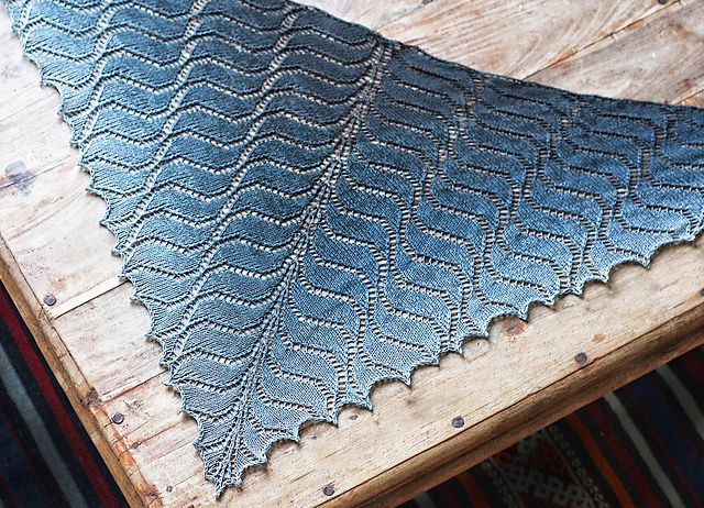 Mirrored waves ripple outwards in a subtle gradation in this modern lace shawl, designed by Nim Teasdale and based on Kieran Foley's original MagicWaves pattern.